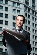 Businessman with newspaper - stock photo