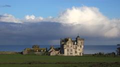 Establishing shot of a beautiful Scottish or English castle estate in sunset - stock footage