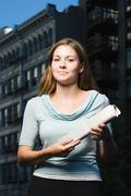 Woman holding newspaper Stock Photos