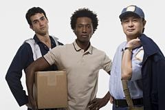 Portrait of a mechanic delivery man and postman - stock photo
