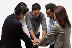 Five office workers showing unity Stock Photos