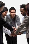 five office workers showing unity - stock photo