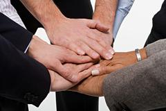 Close up of office workers showing unity Stock Photos