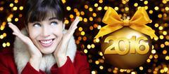 Happy new year 2016, woman looks up on lights background Kuvituskuvat