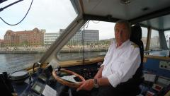 Captain skipper of a water taxi ferry boat sails Stock Footage