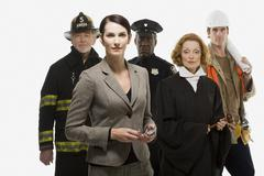 Firefighter police officer judge construction worker and businesswoman Stock Photos