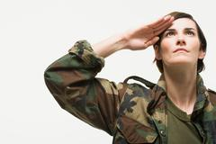 Portrait of a woman soldier - stock photo