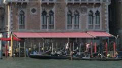 Rowing gondolas near Hotel Bauer Palazzo in Venice Stock Footage
