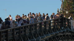 View of the crowded Academy Bridge in Venice Stock Footage
