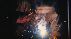 Hard Labour. Electric welder at work. Many sparks Stock Footage