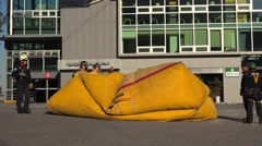 Deflation & packing of the safety air bag by the team of rescuers. Stock Footage