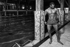 Young Looking Macho Man At Hotel Indoor Pool Stock Photos