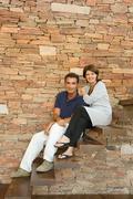 Couple sitting on steps Kuvituskuvat