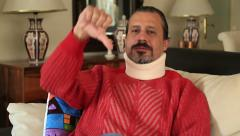 Painful man with neck brace 2 Stock Footage