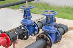 Water valve and steel pipe - stock photo