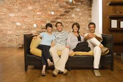 Grown up family on the sofa Kuvituskuvat