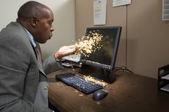 Man blowing gold dust Stock Photos