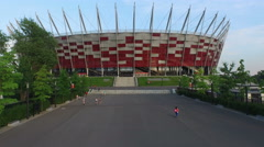 4K Aerial view of people walking by National Stadium in Warsaw Stock Footage