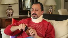 Painful man with neck brace 3 Arkistovideo