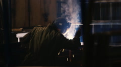 Silhouette of electric welder at work Stock Footage