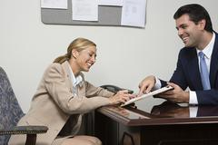 Woman signing contract - stock photo