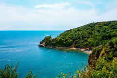 Beautiful bay of Adriatic coast near Budva. Aerial view of Mogren beach - stock photo