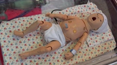 Stock Video Footage of Medical simulation Center. Interactive baby mannequin.