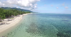 Tracking shot of ocean and mountain on sunny day, Mauritius Stock Footage