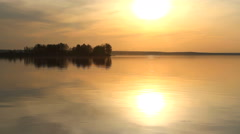 Sun over island on a lake Stock Footage