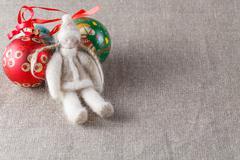 Felt doll with christmas balls Stock Photos