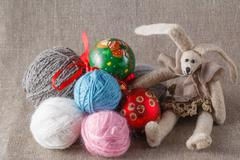 Tilda rabbit doll with clew and cristmas ball - stock photo