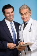 Doctor with a male patient - stock photo