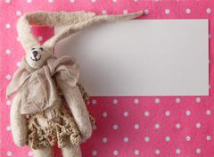 Kid greeting card concept. Felt doll on colorful background Stock Photos