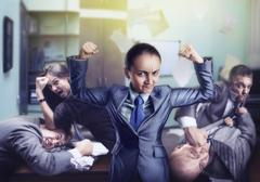 Strong woman in the office - stock photo