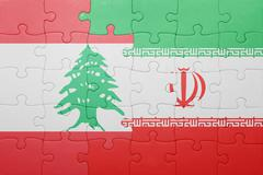 Stock Photo of puzzle with the national flag of iran and lebanon