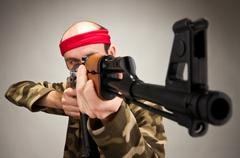 Aiming funny soldier - stock photo