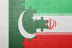 puzzle with the national flag of iran and pakistan - stock photo