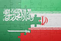 puzzle with the national flag of iran and saudi arabia - stock photo