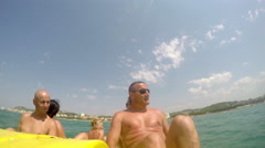 People having summer fun at pedal boat ride. front biew Stock Footage