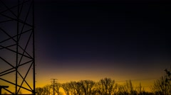 Sun Rising with tower sillhouette Stock Footage