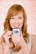Woman using handheld computer Stock Photos
