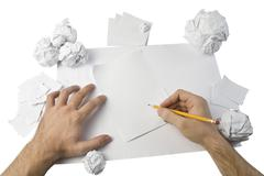 Workspace with crushed paper and hands Stock Photos