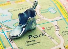road map with statuette shoes.with selective focus - stock photo