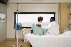 Doctor reassuring patient Stock Photos