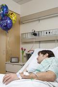 Hospital patient sleeping - stock photo
