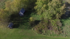 Aerial shot of old sheds on a farm field Stock Footage