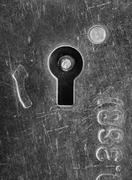 Old scratched lock keyhole - stock photo