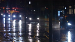 Cars in rain at night Stock Footage