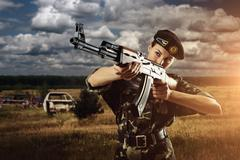 Army soldier woman is on the battle field Stock Photos