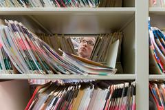 Administrator in archives - stock photo